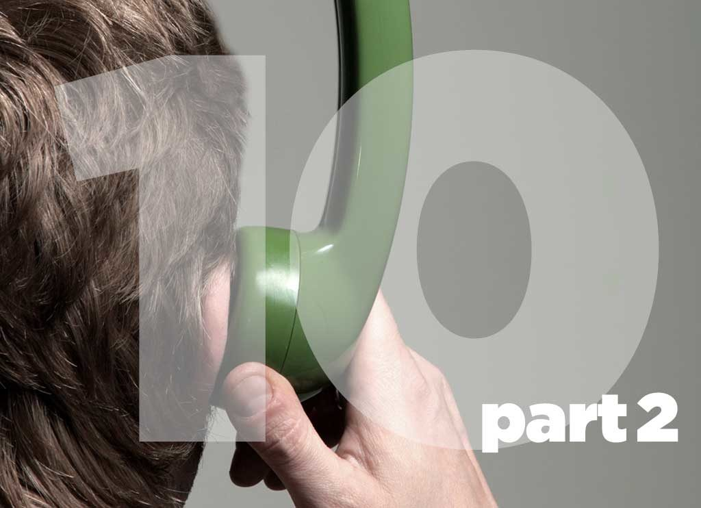 Man holding a phone and listening in the voice side.