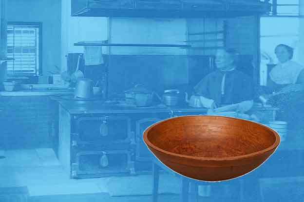 Wood bowl over an historic photo of a shaker kitchen.